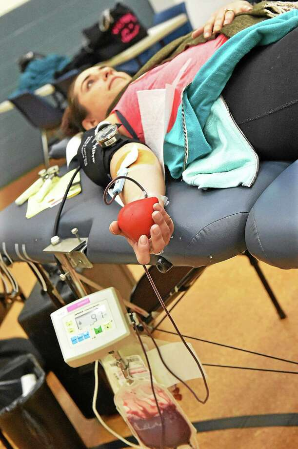 "(Catherine Avalone - New Haven Register) ¬ Milford resident Natasha Nazzaro donates blood at an American Red Cross blood drive held in memory of Sergeant Dario Aponte on Wednesday, December 3, 2014 at the New Haven Police Department gym. Sgt.Aponte was a member of the New Haven Police Department and was killed in the line of duty in 2008. ""It is truly an honor to have a blood drive here at Police Headquarters in New Haven in honor of Sergeant Dario Scott Aponte,"" said Assistant ChiefAnthony Campbell. ""He was not only one of New Haven's Finest; he was one of the finest gentlemen I've ever known."" Photo: Catherine Avalone / Journal Register Co. / New Haven RegisterThe Middletown Press"
