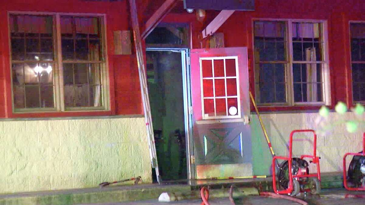 A sedan bursts into flames after crashing into a Bill Miller Bar-B-Q overnight.