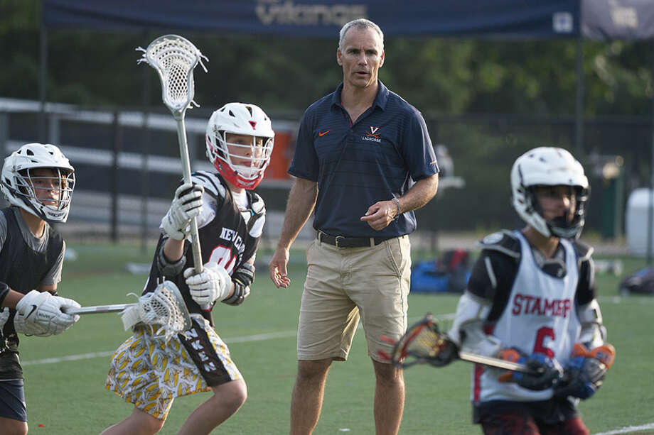 University of Virginia men's lacrosse coach Lars Tiffany coaches some middle school players during a clinic at King School in Stamford on Tuesday, June 25, 2019. Tiffany also gave a talk with a question and answer session at the King Performing Arts Center. — Dave Stewart/Hearst Connecticut Media / Hearst Connecticut Media