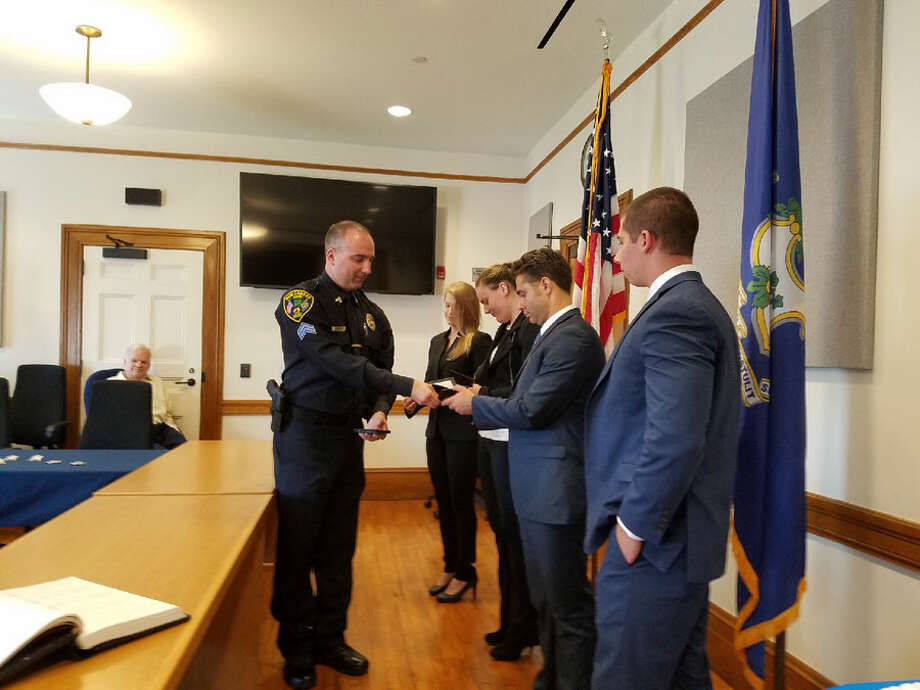 New Canaan Police swore in four new recruits, two of whom are women, at Town Hall on Thursday, June 27, 2019. Grace Duffield / Hearst Connecticut Media / Connecticut Post
