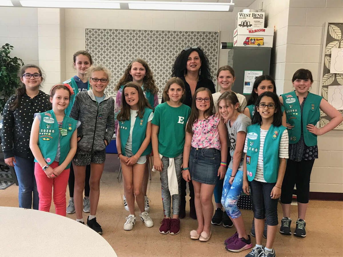 Fifth grade Girl Scouts at Saxe Middle School worked toward their Bronze Award for community service by helping English as a Second Language students in Bridgeport obtain needed supplies. In front, from left, are Evie Morales, Veronika Campbell, Anna Marie Armijo, Ariella Blatt, Caroline Richey Elliot, Eliana Savelli and Kashvi Parashar. In back are Harlow Munoz, Bella DeVito, Maddie Norton, Bridgeport teacher Layla Intellisano, Sophie Dluzyn, Delia Bakal and Emily Barnes. Contributed photo