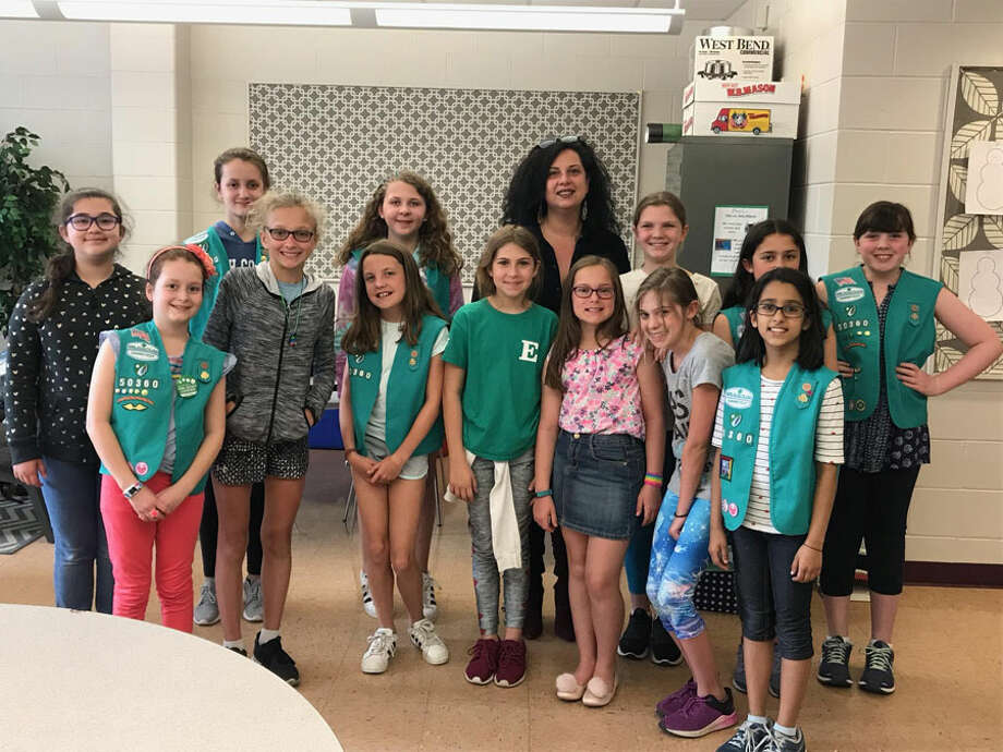 Fifth grade Girl Scouts at Saxe Middle School worked toward their Bronze Award for community service by helping English as a Second Language students in Bridgeport obtain needed supplies. In front, from left, are Evie Morales, Veronika Campbell, Anna Marie Armijo, Ariella Blatt, Caroline Richey Elliot, Eliana Savelli and Kashvi Parashar. In back are Harlow Munoz, Bella DeVito, Maddie Norton, Bridgeport teacher Layla Intellisano, Sophie Dluzyn, Delia Bakal and Emily Barnes. Contributed photo / Connecticut Post