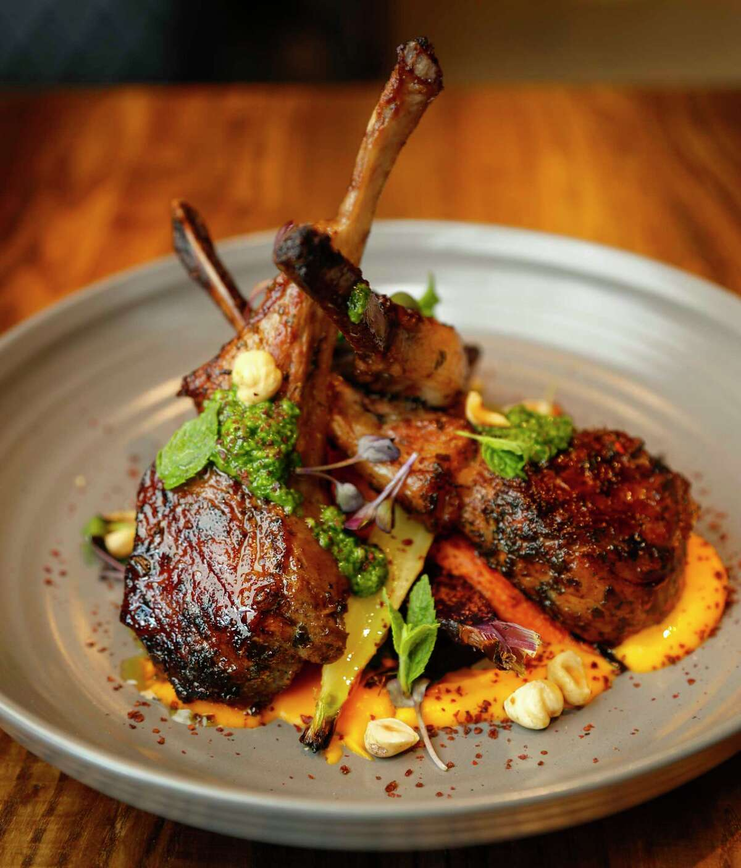 Australian lamb chops: Herb roasted lamb lollipops, oak wood smoked carrots, sweet potato, spinach, and hazelnut pesto with sumac and mint at Warehouse 72.