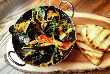 PEI Mussels: Tomato and white wine sauce, saffron, fennel, calabria peppers, and herbs at Warehouse 72,Monday, July 8, 2019, in Houston. Warehouse 72 is a new-concept Spaghetti Warehouse, which will be opening soon at 7620 Katy Fwy.