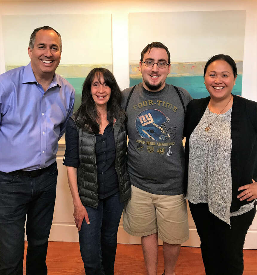 STAR-Job-Coach Joe-Anastasi and Employment-Manager Channyra-Than flank STAR mother Diane-Ballarino and Austin-Star-of New Canaan, who has been is succeeding in jobs he was placed into by STAR. STAR / Contributed photo / Connecticut Post