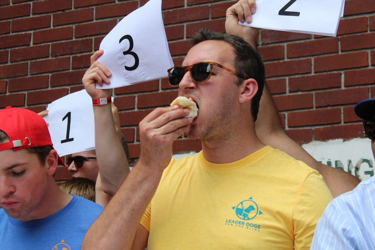 Eaters had to finish hot dog and bun in the Make Hot Dogs Great Again eating contest at the White Buffalo in New Canaan, Connecticut, on June 22, 2019, a benefit for Leader Dogs for the Blind. John Kovach / Hearst Connecticut Media The challenge has evolved as it has grown. This year, rather than just eating a hot dog, documented by a selfie, every day, participants are making videos, which are judged on creativity.