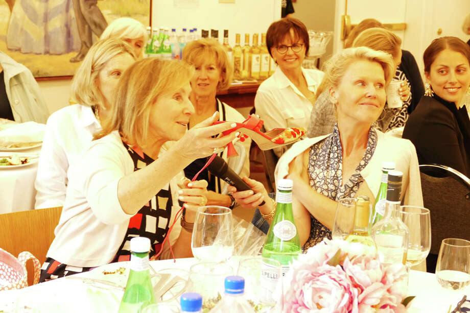 """Women showed shoes that evoked memories to 70 other women who attended the New Canaan Museum and Historical Society's event, """"The Mystique of Shoes,"""" which was held on Thursday, June 20, 2019. Grace Duffield / Hearst Connecticut Media / Connecticut Post"""