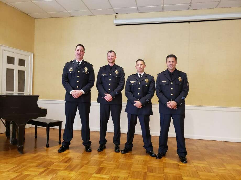 Darien's Police Department promotion ceremony celebrated the recent promotions of four Darien police officers: Capt. Jeremiah Marron, Jr., Lt. Nicholas Aranzullo, Sgt. Derek Mulcahy, and Sgt. Daniel Skoumbros. — Sandra Diamond Fox photo
