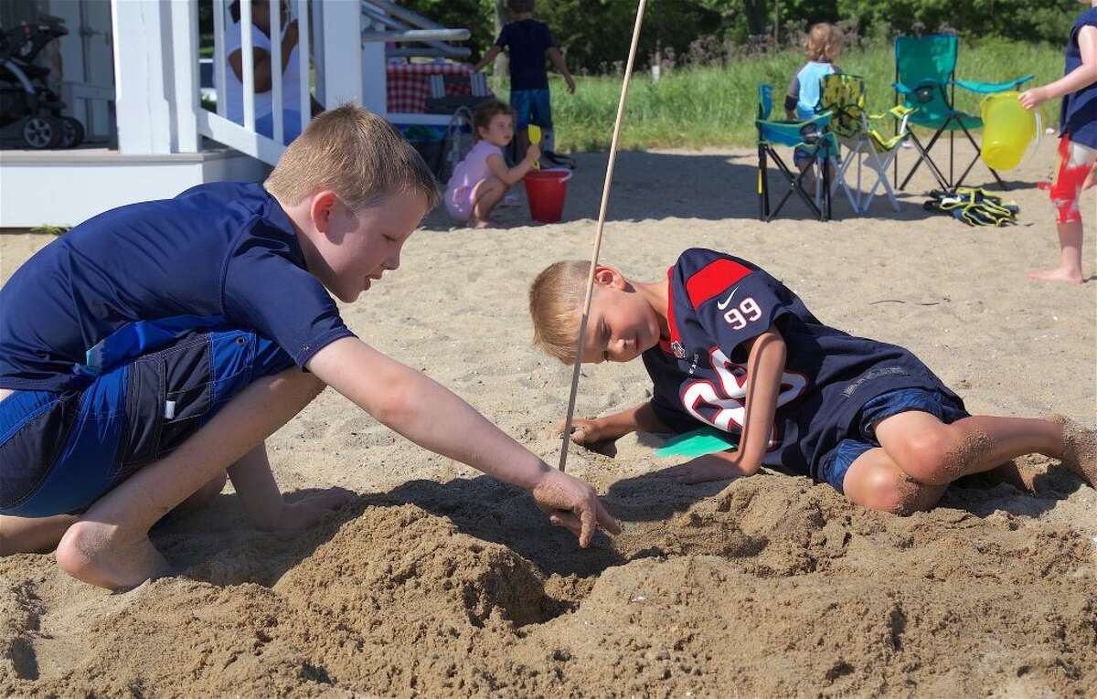 -Lincoln Snell, 8, left, and Thomas Keefe, 7, both of Darien, discuss the plans for their sand castle at the Weed Beach competition on Wednesday afternoon.