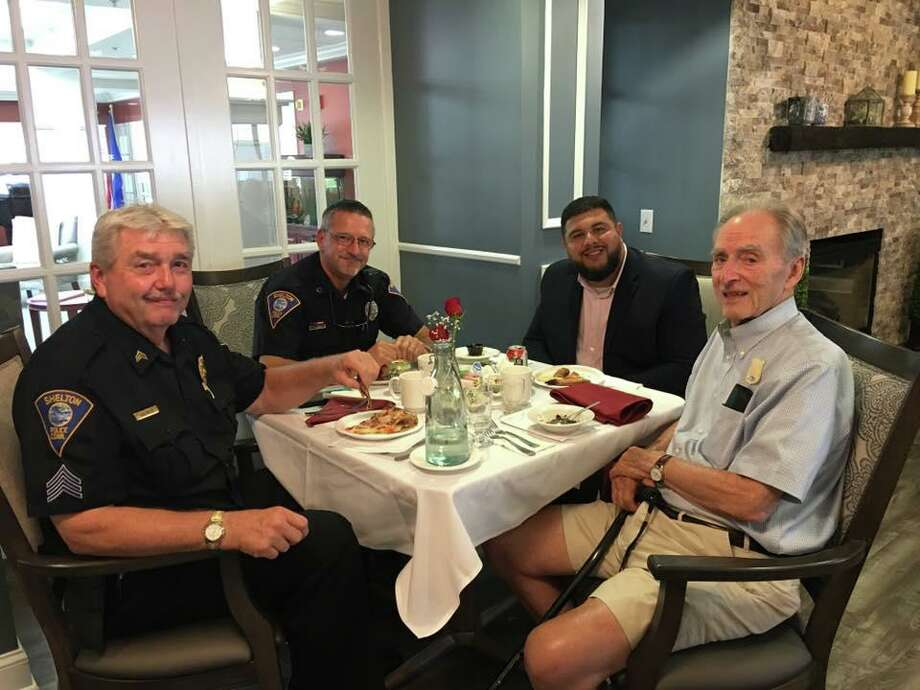 Members of the Shelton Police Department spent June 26 enjoying some good conversation and even better wood-fired pizza with residents at Crosby Commons. Chef Hector made his famous pizzas, and the officers left with a special token of the residents' appreciation. This is the second year Crosby Commons has hosted members of the department. The residents got to interact and even sit in a police car. The officers that could not make the visit were sent pizzas to bring back to the station. Photo: Contributed Photo