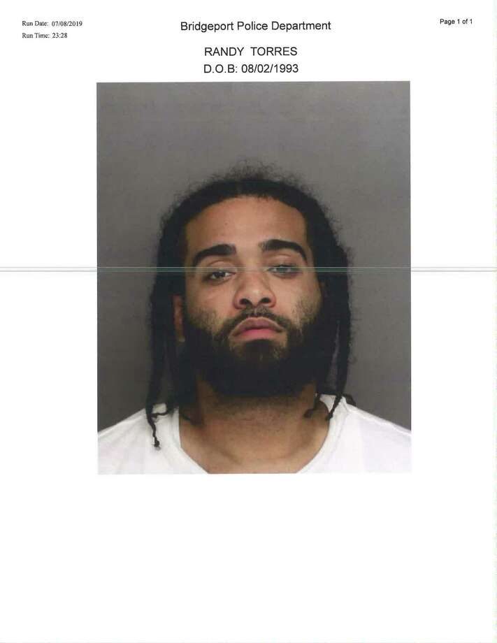 Randy Torres, a 25-year-old resident of Houston Avenue was taken into custody by various forces Monday morning in connection with a July 6 shooting. Photo: Courtesy Of The Bridgeport Police Department