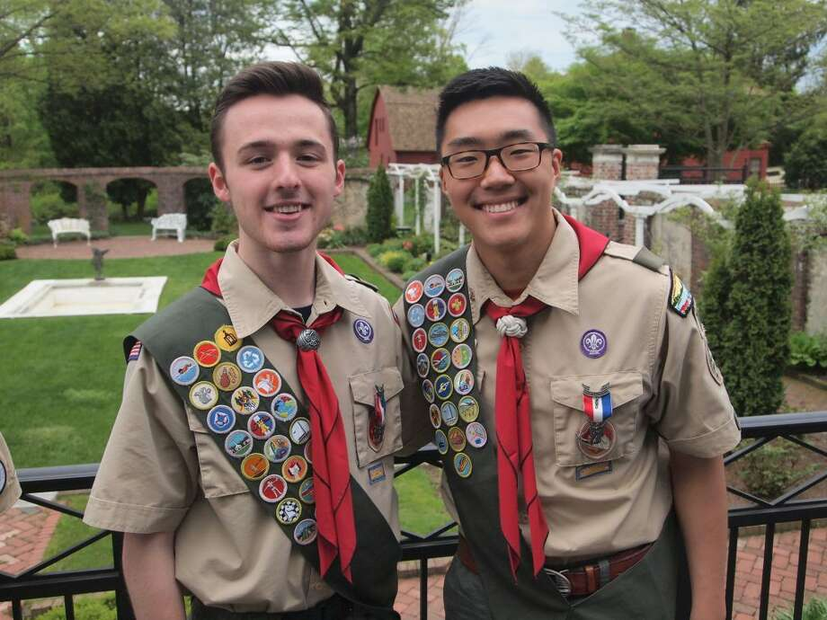 Boy Scouts from Troop 76 Clay Vaughan, left, and Thomas Vilinskis, right, became Eagle Scouts last month. The distinction requires that a scout earn 21 merit badges, serve in a leadership position and complete a significant community project.