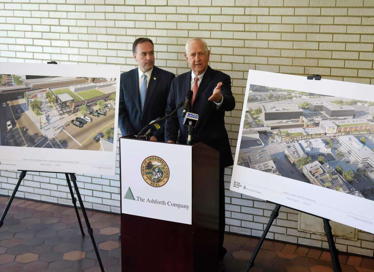 Greenwich First Selectman Peter Tesei, left, and The Ashforth Company co-CEO H. Darrell Harvey speak beside architectural renderings of the proposed new train station at the Greenwich Train Station in downtown Greenwich, Conn. Tuesday, July 9, 2019. Tesei is delaying a request to the RTM that the deal be considered but Ashforth is still going ahead with seeking zoning approvals.