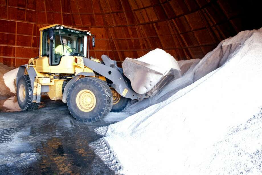 Rich Velleco operates a payloader as he fills Department of Public Works trucks with road salt in preparation for the forecast snowstorm in Ansonia. Ridgefield is looking to cut down on its use of road salt.