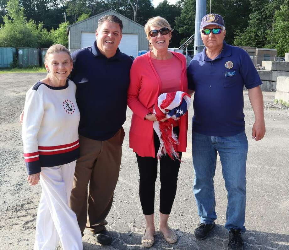 Trumbull Town Clerk Suzanne Burr Monaco with State Rep. David Rutigliano along with State Rep. Laura Devlin, and A. V. Napolitano American Legion Post 141 Commander Ernie Foito honoring Flag Day.