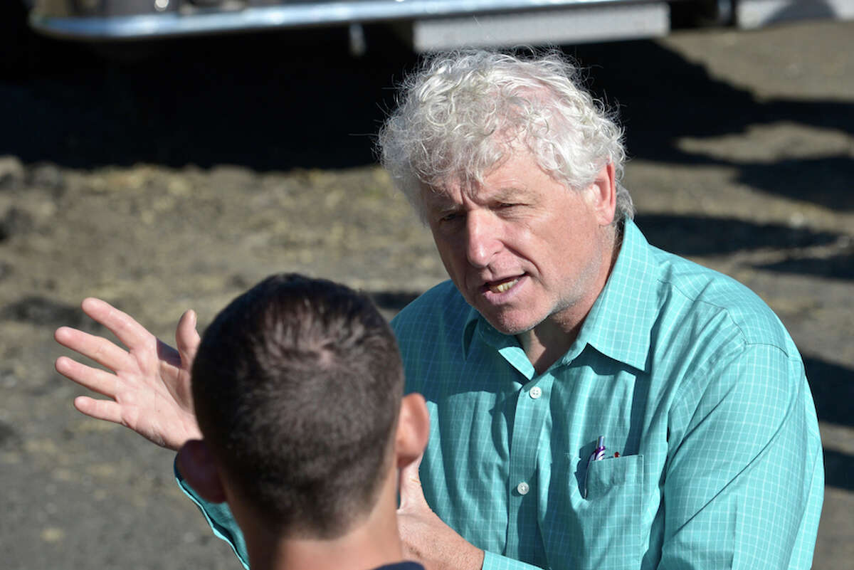 Former Danbury Fire Chief Geoffrey Herald talks with a reporter at the official ground breaking for a new building at Danbury's fire training facility. in August 2015. The retired chief worked to get the project underway and the funding started when he was with the department. - H. John Voorhees III/Hearst Connecticut Media