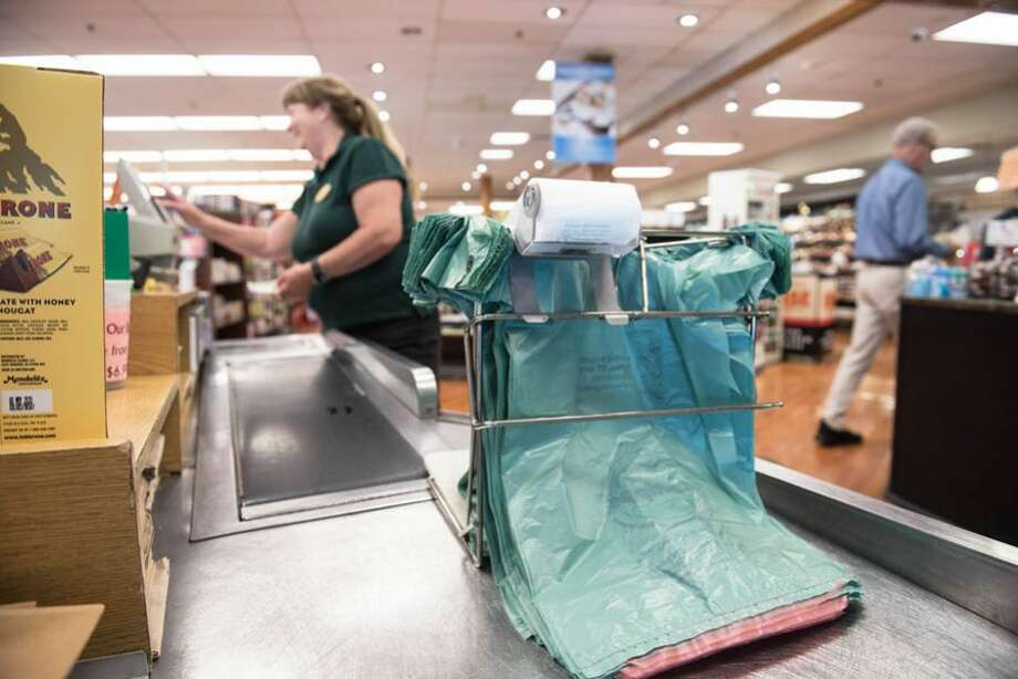 Starting Aug. 1, plastic bags like these at Village Market will cost consumers 10 cents each. A permanent plastic bag ban goes in effect on July 1, 2021. — Bryan Haeffele/ Hearst Connecticut Media photo
