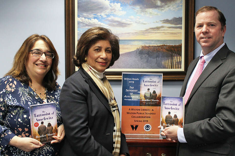 Fran Kompar, the school district's digital learning director, left, Wilton Library Executive Director Elaine Tai-Lauria, and Superintendent of Schools Kevin Smith at the rollout of the Wilton Reads program.