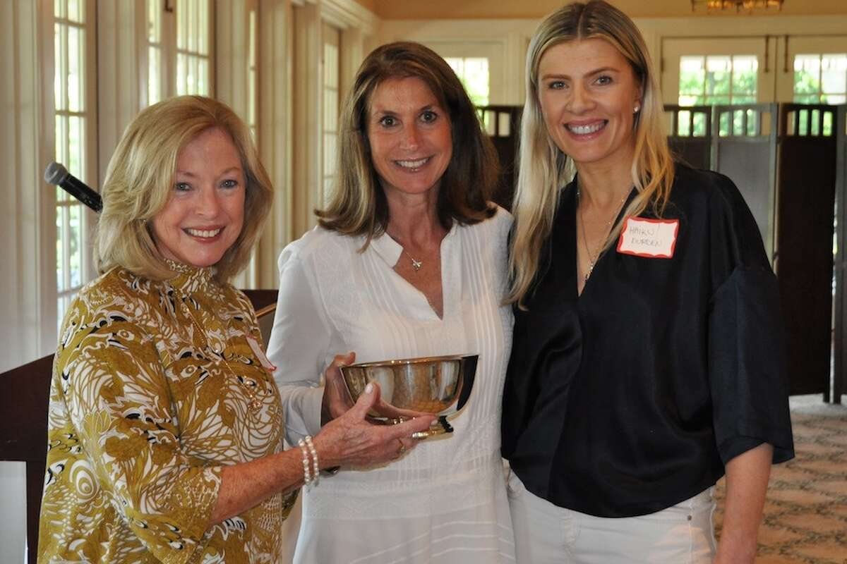 The Wilton Garden Club's President's Award of Excellence is given to publicity co-chairs Sherry Johnson, left, and Haiku Durden, right, by club president Suzanne Knutson.