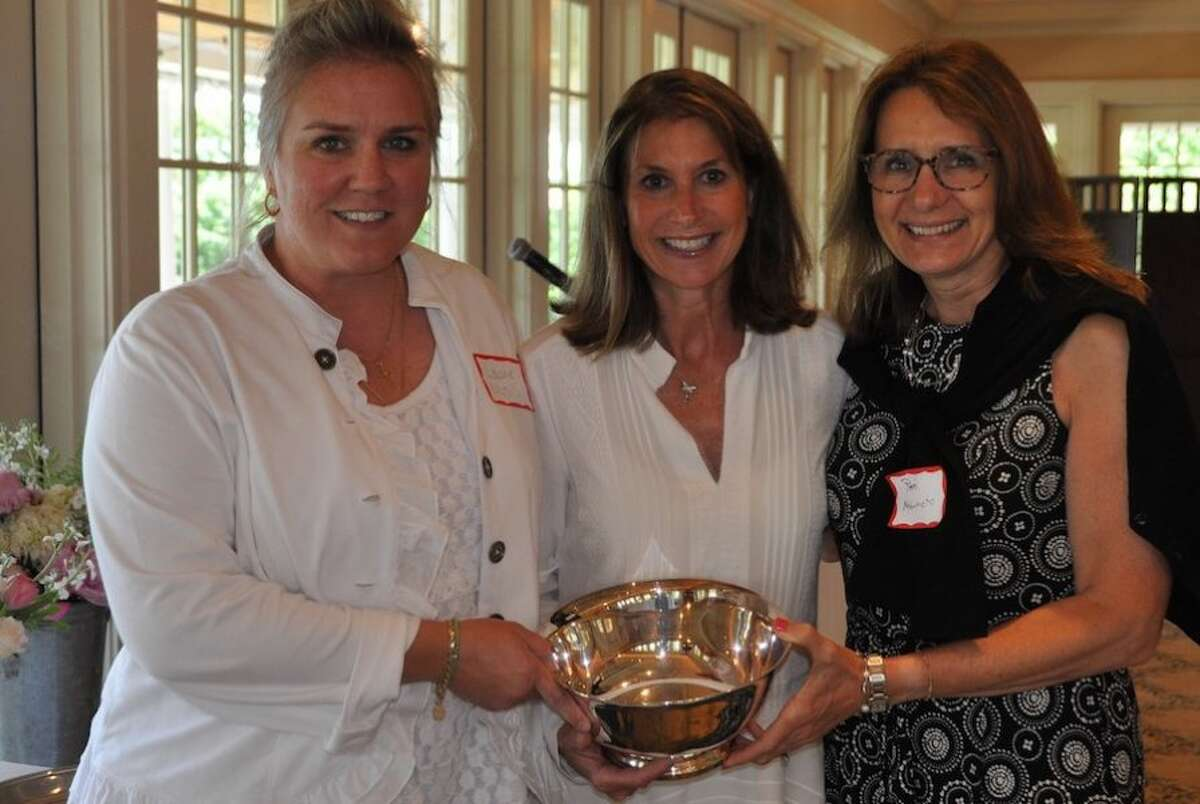 Laurie Musilli, left, and Pam Nobumoto, right, receive the Wilton Garden Club's President's Award of Distinction for their work with the club's Green Teens youth gardening program. With them is club president Suzanne Knutson.