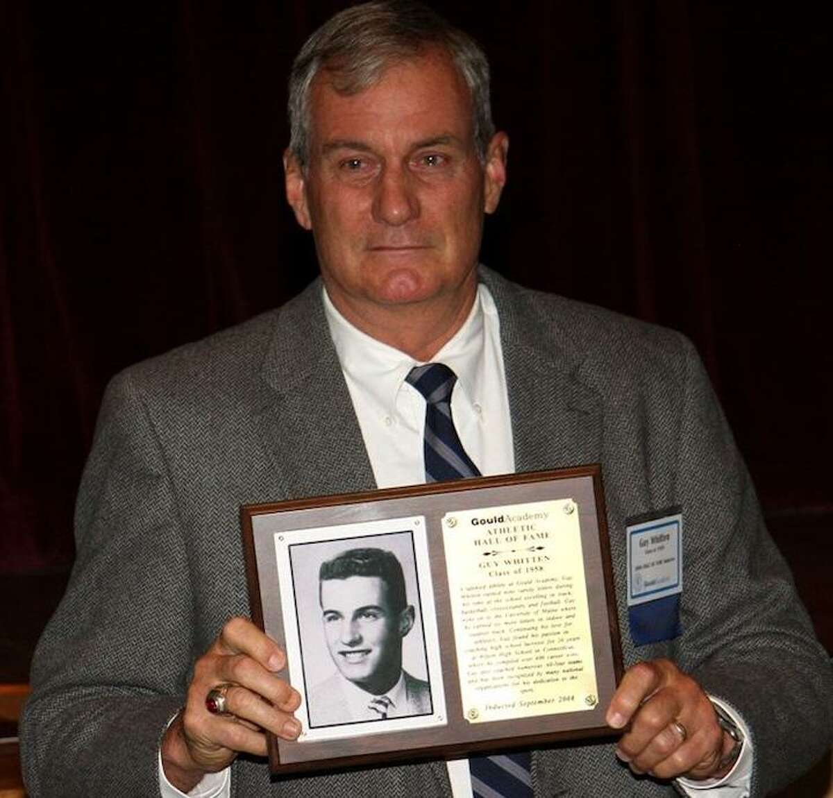 Former Wilton High boys lacrosse coach Guy Whitten is among seven inductees in the Fairfield County Sports Hall of Fame's 2019 class. Whitten is shown with a plaque he received after being enshrined in the University of Maine's Gould Academy Athletic Hall of Fame.