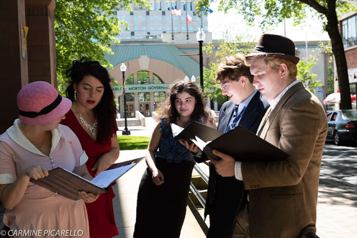 Director and writer Melody Rose, center, works with actors, from left, Kaitlyn O'Shea, Michelle Mason, Richard Eyler and Jon Paul Watts on her play,