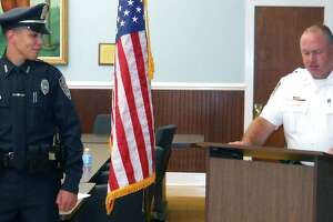 Danbury officer Alex Relyea shot 31-year-old Aaron Bouffard in July and 45-year-old Paul Arbitelle in December. In this file photo, Relyea is addressed by Chief Shawn Boyne moments after being sworn in to serve in the New Milford Police Department during a July 11, 2012 ceremony in the E. Paul Martin Meeting Room at New Milford Town Hall. Courtesy of the New Milford Police Department