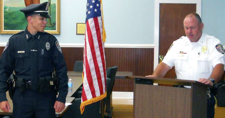 Danbury officer Alex Relyea shot 31-year-old Aaron Bouffard in July and 45-year-old Paul Arbitelle in December. In this file photo, Relyea is addressed by Chief Shawn Boyne moments after being sworn in to serve in the New Milford Police Department during a July 11, 2012 ceremony in the E. Paul Martin Meeting Room at New Milford Town Hall. Courtesy of the New Milford Police Department Photo: Contributed Photo / Contributed Photo / The News-Times Contributed