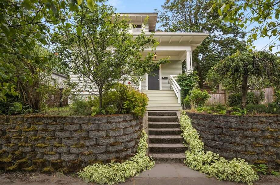 Listed at $699,990: This 1904 two-story Craftsman home offers three bedrooms, one bathroom in Seattle's Central District. Located at 2311 E Alder St. See the full listing here. Photo: Courtesy Redfin