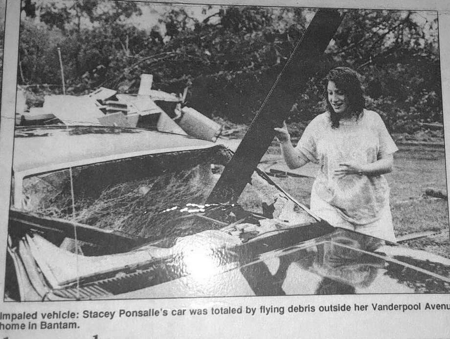 A resident stands by her car after the tornado blasted its way through the borough of Bantam on July 10, 1989. Photo: Bantam Historical Society / Contributed Photo /