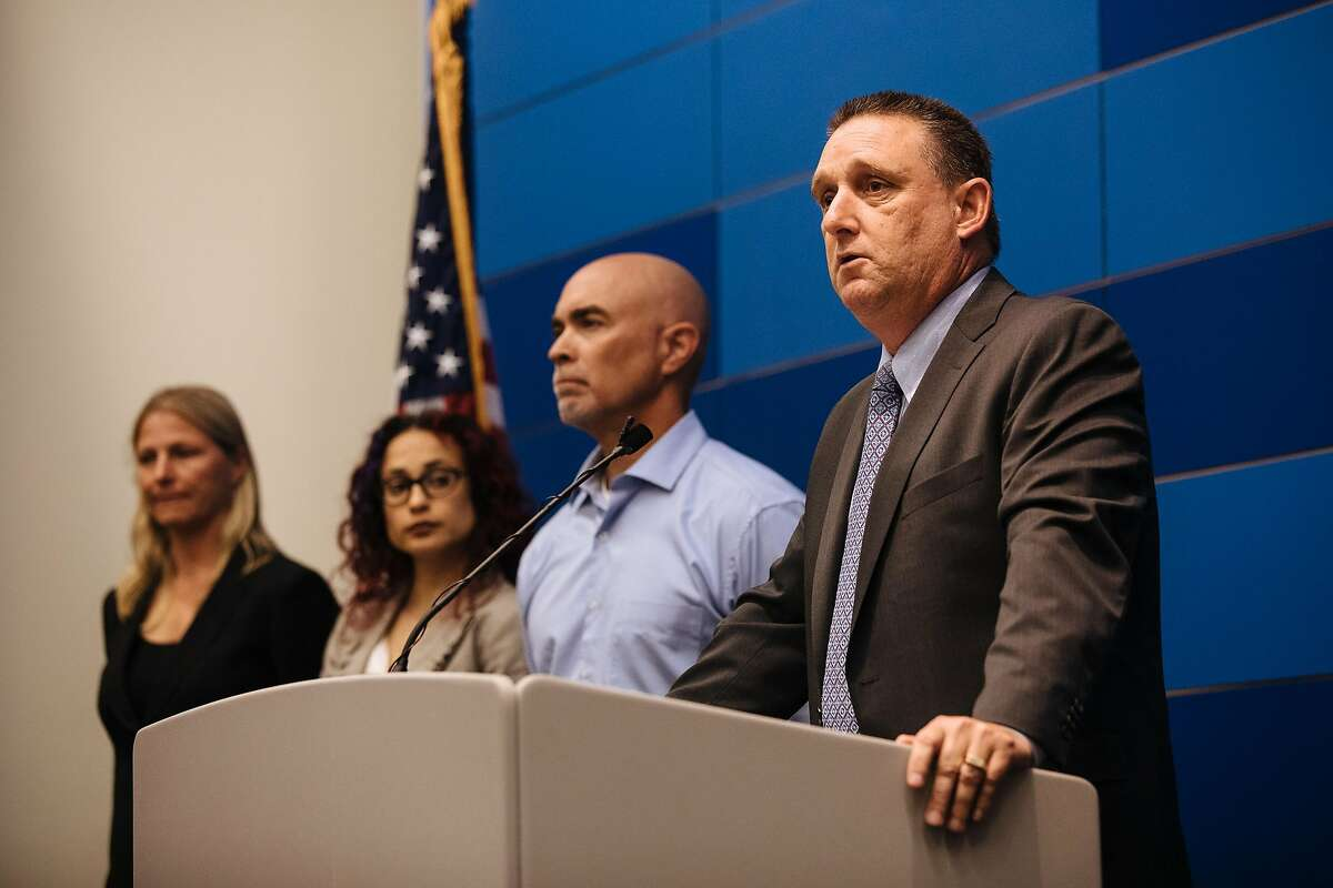 San Francisco Police Department's Commander of the Investigations Bureau, Greg McEachern, right, addresses the press about the arrest of serial rapist, Orlando Vilchez Lazo, during a press conference at the San Francisco Police Department in San Francisco, Calif., on Friday, July 13, 2018.
