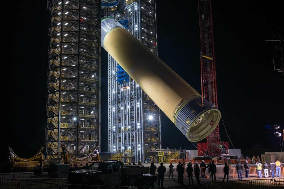 The Space Launch System liquid hydrogen tank structural test article is loaded into Test Stand 4693 at NASA's Marshall Space Flight Center in Huntsville, Alabama, on Jan. 14, 2019. The 149-foot piece of test hardware is the largest piece of structural hardware for the SLS core stage for America's new deep space rocket. The tests will help ensure designs are adequate for successful SLS missions to the moon and beyond. (NASA)