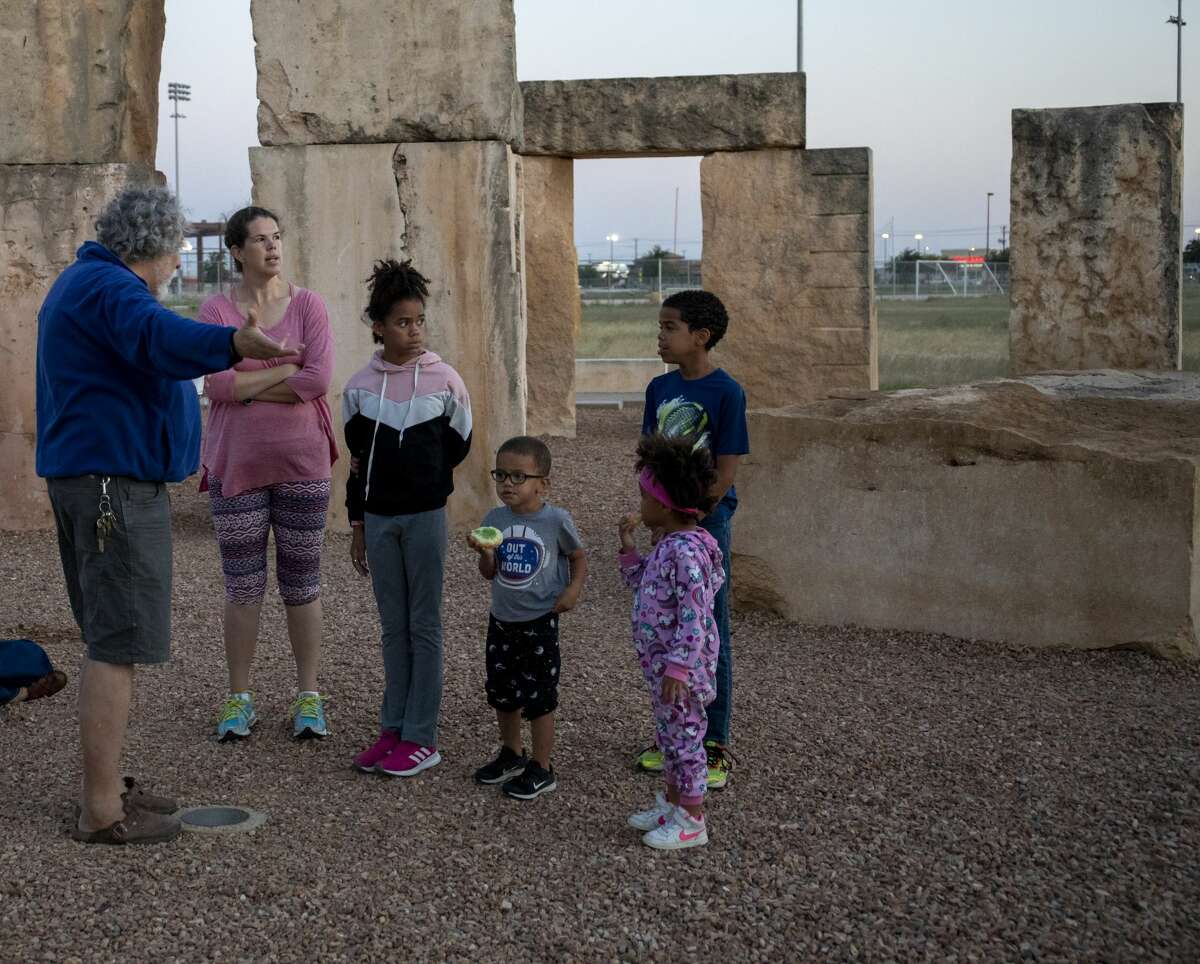 Chris Stanley talks to Teri, Milana, Eilon, Isaac and Emri Young about the Stonehenge Replica and summer solstice on Friday, June 21, 2019 at the Stonehenge Replica at the University of Texas of the Permian Basin.