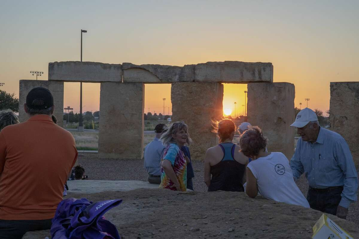People gather to watch the sunrise for summer solstice on Friday, June 21, 2019 at the Stonehenge Replica at the University of Texas of the Permian Basin.