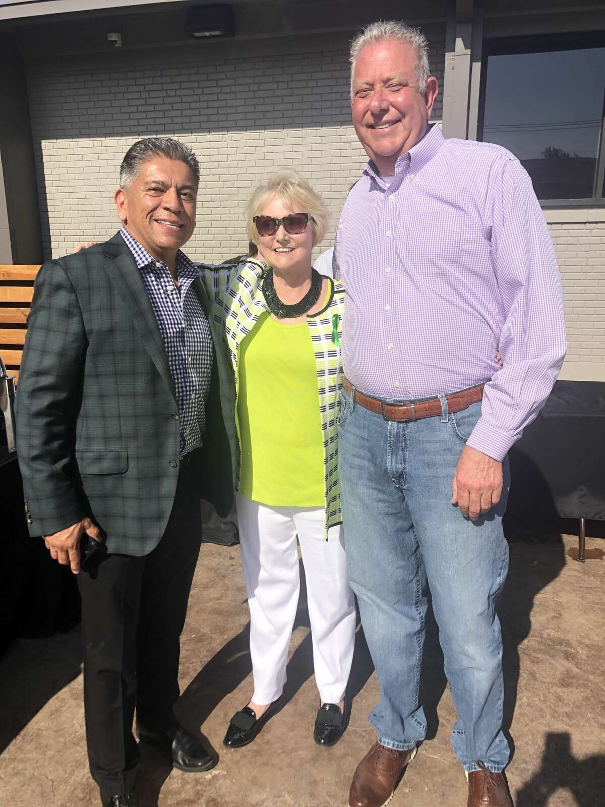 Centers courtyard: Jerry Morales, from left, Ann Bradford and Joe Kelley