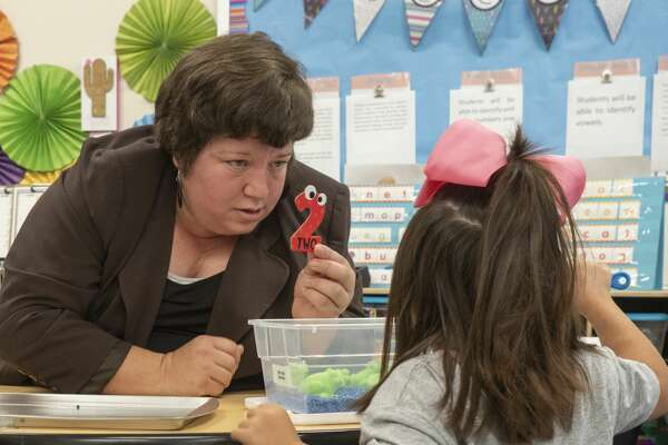 General Franks Elementary life skills teacher Blanca Garrido-Goyo works with some of her students 05/22/19 on numbers and hand eye coordination. Tim Fischer/Reporter-Telegram