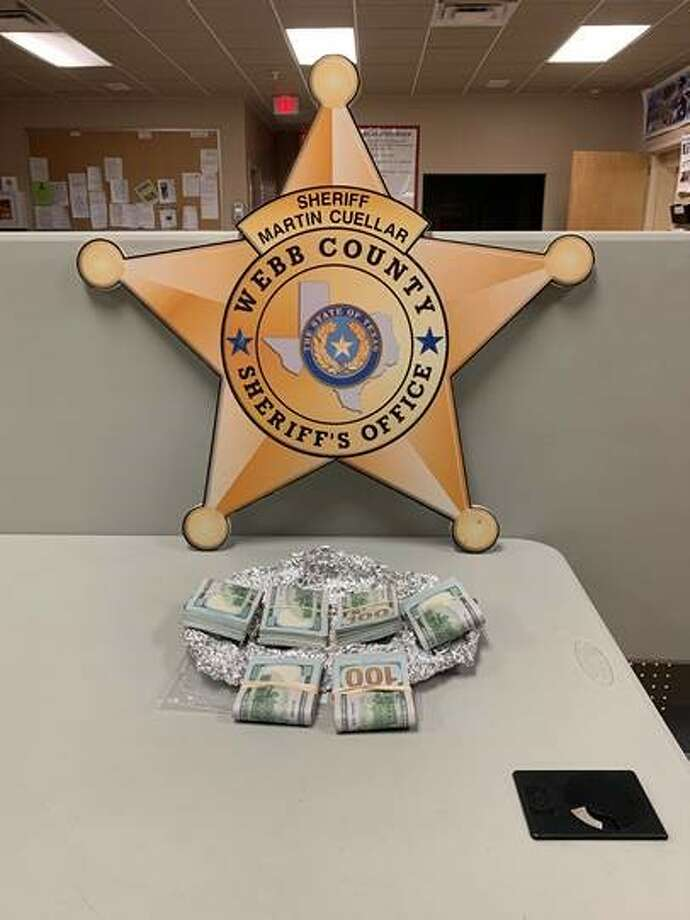 These are the $30,000 the Webb County Sheriff's Office seized on Friday during a traffic stop along Interstate 35 in northern Webb County. Photo: Courtesy