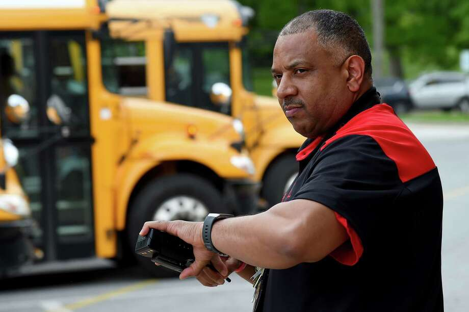 Principal David Burton of Glenelg High School checks his watch as buses prepare to depart at Glenelg High School in Glenelg, Maryland on May 10, 2019. Photo: Photo By Will Newton For The Washington Post. / For The Washington Post