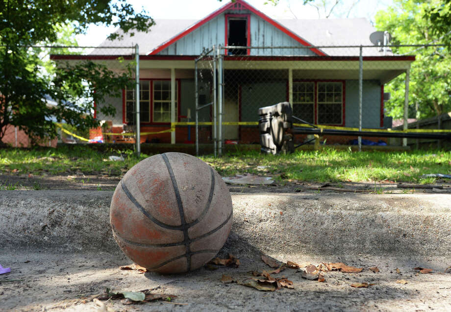 A basketball sits by the curb next to the Beaumont home where a 19-year died during a fire on Tuesday. The boy was known by neighbors as fan of the game and played regularly on a goal across the street.  Photo taken Tuesday, 7/9/19 Photo: Guiseppe Barranco/The Enterprise / Guiseppe Barranco ?
