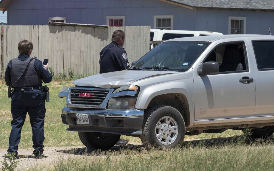 Midland Police investigate an accident 07/09/19 where a pedestrian was hit by a GMC pickup truck driving northbound on Big Spring St near the intersection of California Ave. Tim Fischer/Reporter-Telegram Photo: Tim Fischer/Midland Reporter-Telegram