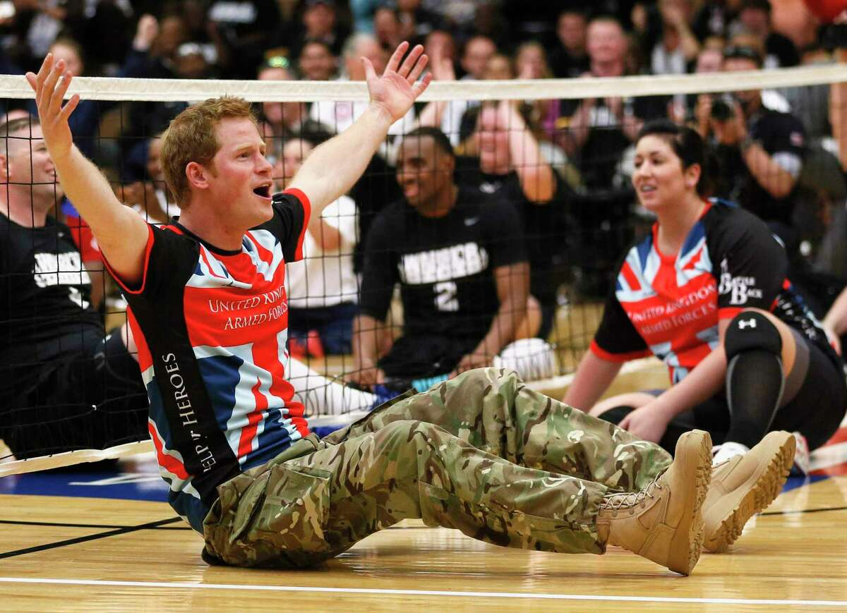 Britain's Prince Harry reacts while playing sitting volleyball with members of the British Warrior Games team in a gymnasium before the opening of the Warrior Games at the U.S. Olympic Training Center in Colorado Springs, Colorado in May 2013. The Warrior Games, organized by the U.S. Department of Defense, is a Paralympic-style competition featuring injured servicemen and women from six nations.