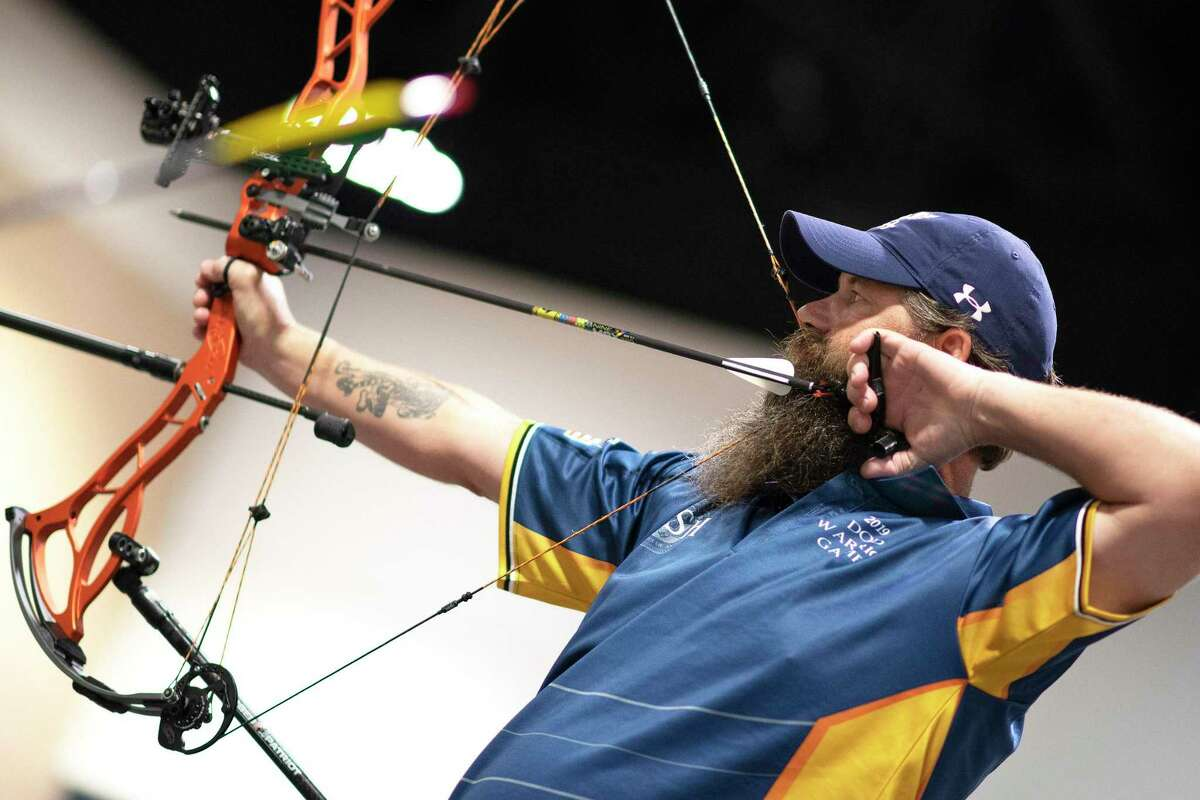 U.S. Navy veteran Chief Petty Officer Joshua Erickson, Team Navy, draws an arrow during the archery finals of the 2019 DoD Warrior Games in Tampa, Florida, on June 25. San Antonio will host the games in September 2020. The games showcase the talents of military members who have been wounded or ill. About 500 athletes from five branches of the U.S. military and serviceme and women from five other countries are expected to participate.