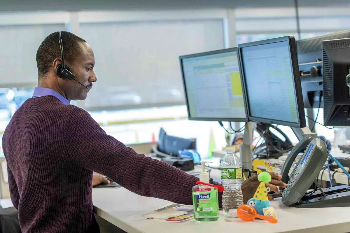 A Synchrony Financial employee at work in November 2016 at the retail finance giant's headquarters in Stamford, Conn. Financial services employ the highest percentage of people in their