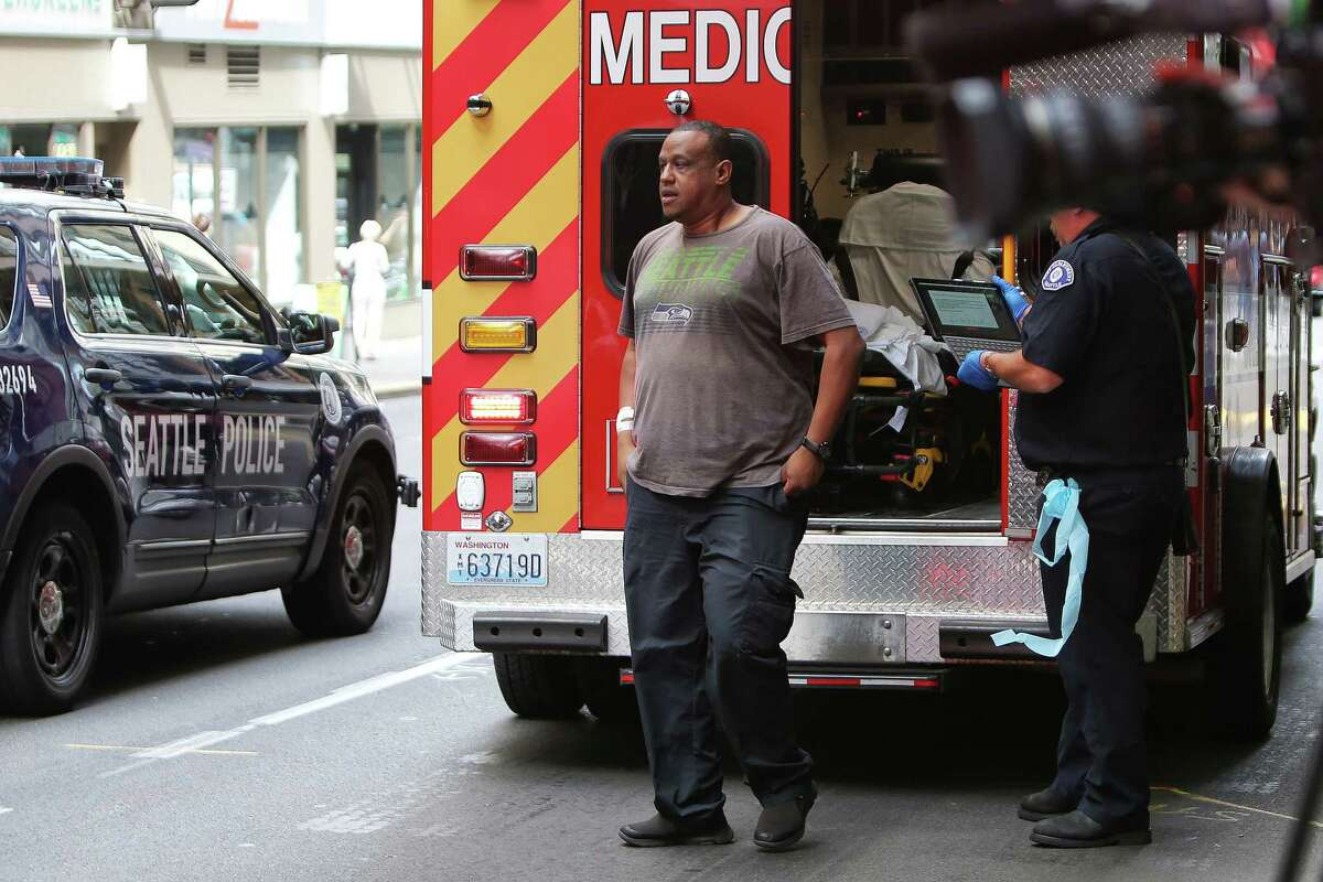 A victim of a stabbing outside of Nordstrom on 6th Avenue, who declined to be transported to the hospital, steps out of an ambulance after recieving treatment from paramedics, Tuesday, July 9, 2019. Tuesday afternoon a man reportedly stabbed three people on the sidewalk, including a 77 and a 75-year-old man who were both transported to Harborview Medical Center and are in stable condition. The suspect was apprehended several blocks away.