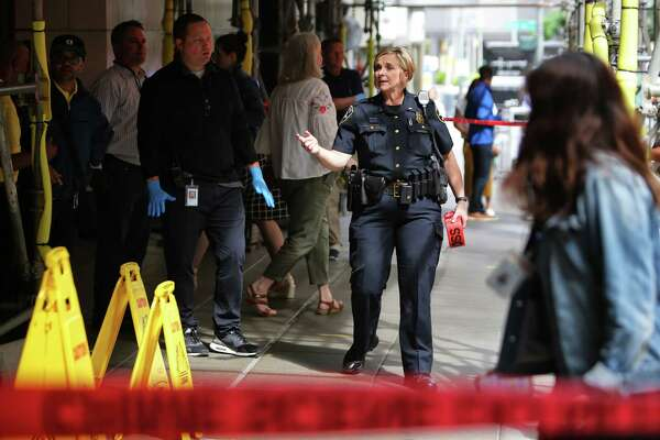 Police investigate a crime scene outside of Nordstrom, Tuesday afternoon, where a man reportedly stabbed three people on the sidewalk, including a 77 and a 75-year-old man who were both transported to Harborview Medical Center and are in stable condition. The suspect was apprehended several blocks away. The third victim had minor injuries and refused transport to the hospital.