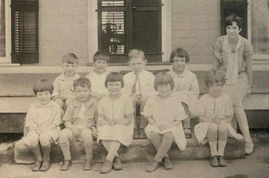 "Many children from New Milford attended the former Miss Barton's School in town. According to the records of E. Paul Martin, ""Edith Barton operated the school for 50 years, with the doors closing in 1976 due to failing health. Barton was one of five daughters of the W.G. Barton family. Mr. Barton moved into New Milford in the late 1800s and started a dry goods business. His business and building were completely destroyed during the big New Milford fire in 1902. He rebuilt on Bank Street and managed the business for a good many years before he died. It was then operated by two of his three sons, Willis and Paul, for a number of years."" This photograph depicts the 1927-28 class of Miss Barton's School. They are, from left to right, in front, Virginia Robertson, Jimmie Carroll, Priscilla Chalmers, Natalie Scholze, Jean Marsh and teacher Margaret Chapman, and in back, Paul E. Martin, Samuel B. Ferriss, Henry M. Brant and Mary Robertson, according to E. Paul Martin records. If you have a ""Way Back When"" photo you'd like to share, contact Deborah Rose at drose@newstimes.com or 860-355-7324. Photo: Courtesy Of E. Paul Martin's Family / The News-Times Contributed"
