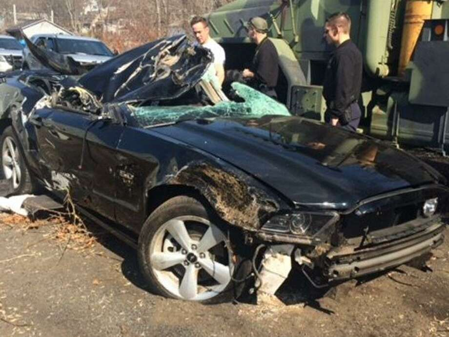 While Mark Smolen of Shelton was driving up Route 8 back in 2016, a tire came off a trailer being towed in the opposite direction, came across the median, and smashed through his windshield, striking Mark in the face, causing his car to swerve off the highway and end up on its roof in the woods. Photo: Contributed Photo