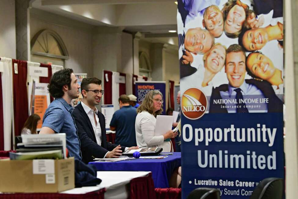 Job seekers talk to representatives from different companies during the Times Union job fair at the Albany Marriott on Tuesday, July 9, 2019 in Albany, N.Y. (Lori Van Buren/Times Union)