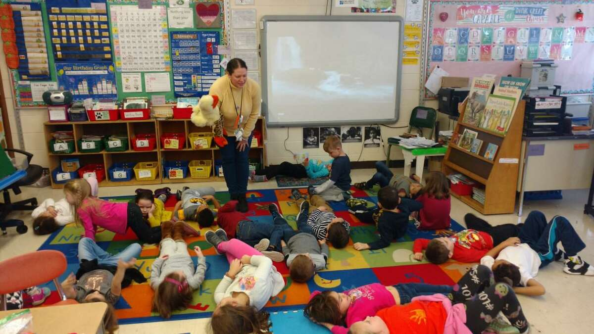 Booth Hill School kindergarten teacher Kim Atkinson using sensory techniques with her students.