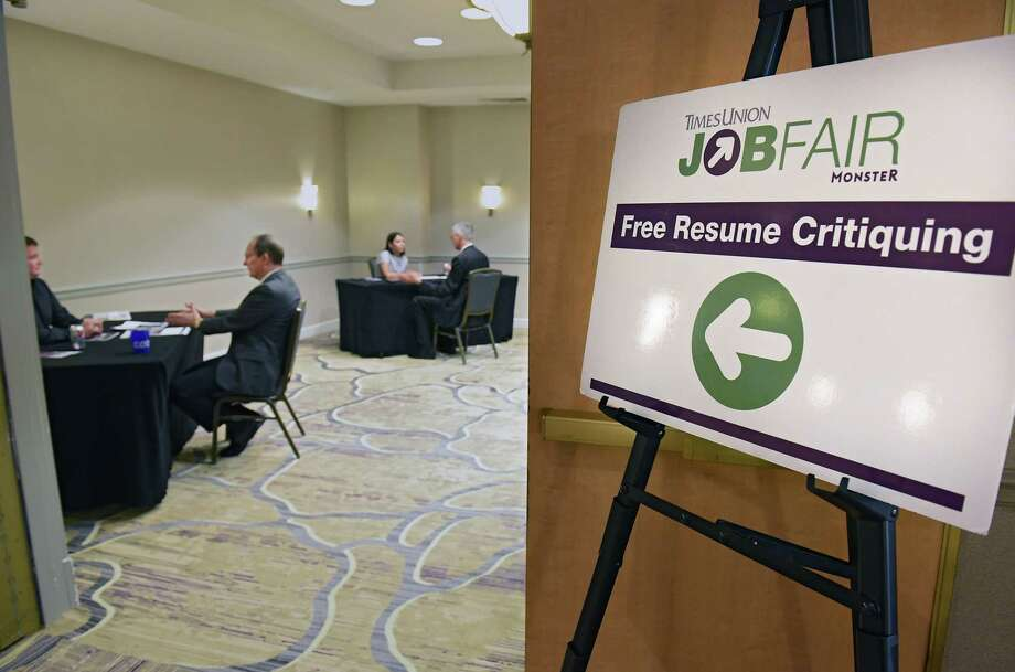 Job seekers get free resume critiques during the Times Union job fair at the Albany Marriott on Tuesday, July 9, 2019 in Albany, N.Y. (Lori Van Buren/Times Union) Photo: Lori Van Buren, Albany Times Union / 40047439A